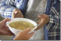 Hands of Homeless Man Receiving Bowl of Soup --- Image by © Royalty-Free/Corbis